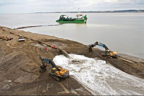 Material dredged from the river bed is being used to create the new quay. Once completed the site will be raised by 3m